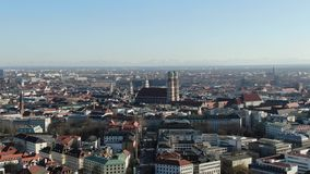 Historic Frauenkirche church with massive city of Munich on the background, 4k. Aerial footage of Munich with its amazing european architecture and historic stock video