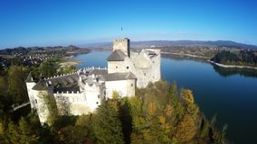 Aerial footage of Niedzica Castle at Czorsztyn Lake in Poland stock video footage
