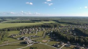 Aerial footage over a classica European housing estate, homes from above. Aerial shot over the top of housing estate. Aerial view over the village 4K stock footage