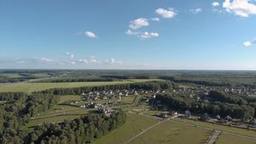 Aerial footage over a classica European housing estate, homes from above. Aerial shot over the top of housing estate. Aerial view over the village 4K stock video footage