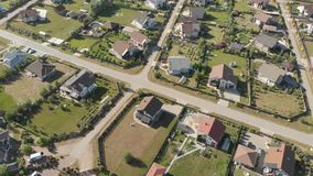 Aerial footage over a classica European housing estate, homes from above. Aerial shot over the top of housing estate. Aerial view over the village. Video stock footage