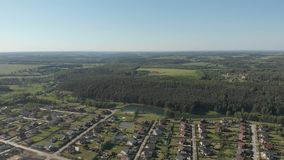 Aerial footage over a classica European housing estate, homes from above. Aerial shot over the top of housing estate. Aerial view over the village. Video stock video
