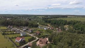 Aerial footage over a classica European housing estate, homes from above. Aerial shot over the top of housing estate. Aerial view over the village 4K stock video