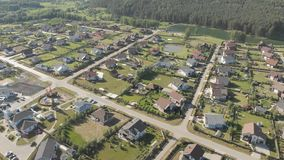 Aerial footage over a classica European housing estate, homes from above. Aerial shot over the top of housing estate. Aerial view over the village. Video stock video footage