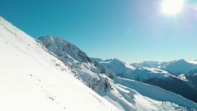 Aerial footage of the peak of Blackcomb mountain on a sunny day. stock video