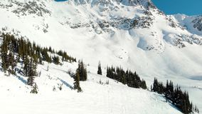 Aerial footage of the peak of Blackcomb mountain on a sunny day. stock footage