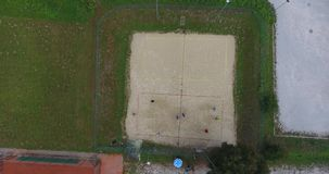 Aerial footage of people playing beach volleyball. stock footage