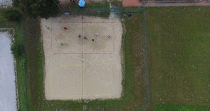 Aerial footage of people playing beach volleyball. stock video