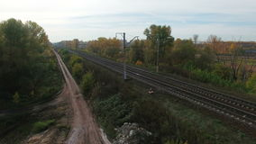Aerial footage of railway and dirt road. Flying over of railway and dirt road . Drone moving down. 4K Aerial stock footage clip stock footage