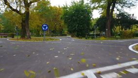 Aerial footage of road signs for the cyclists in autumn park stock video