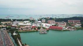 Aerial footage of Sentosa Island Singapore. Singapore. November 21, 2017: Beautiful aerial footage of Sentosa Island Singapore from a drone flying forward. Shot stock footage