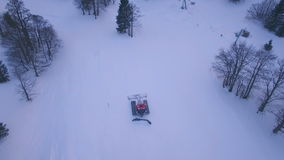 Aerial footage of snow cat stock video