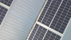 Aerial footage of solar electricity power plant panels on an industrial roof top stock video footage