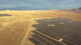 Aerial footage. Solar Energy Farm at Atacama Desert, Chile. Thousands solar modules rows passed along the Solar Energy PV Plant an
