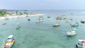 Fishing Boats Sri Lanka Aerial 4k. Aerial footage of some fishing boats in the Weligama Bay in Sri Lanka. Slowmotion footage in 4k stock video