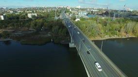 Aerial footage of traffic at bridge. Flying over Samara river. Car traffic at the  bridge.  Drone moving forward. 4K Aerial stock footage shot at autumn season stock footage