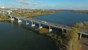 Aerial footage of traffic at bridge. Flying over Samara river. Car traffic at the  bridge.  Drone moving forward. 4K Aerial stock footage shot at autumn season stock video