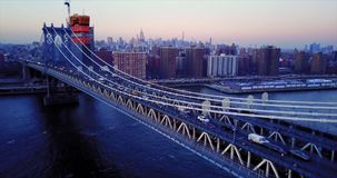 Aerial footage, traffic cars on the bridge and under the bridge in New York 4K. Across East River stock video