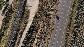 Highway 395 of California and Nevada border. Aerial footage of traffic on Highway 395 along the Nevada and California border stock video footage