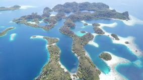 Aerial footage of tropical islands in Raja Ampat. The remote and healthy coral reefs found around the islands of Pef, Raja Ampat, Indonesia, are surrounded by stock video