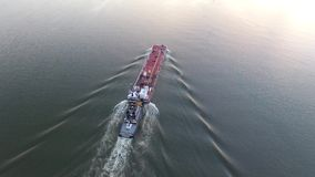 Aerial Footage of Tugboat and Barge on Delaware River stock video footage