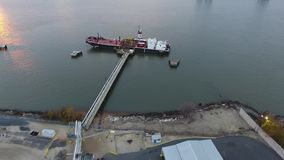 Aerial Footage of Tugboat and Barge on Delaware River. Philadelphia PA stock video