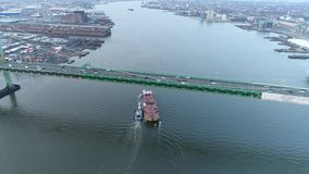 Aerial Footage of Tugboat and Barge on Delaware River. Philadelphia PA stock video footage
