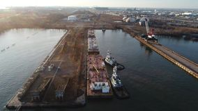 Aerial Footage of Tugboat and Barge on Delaware River. Philadelphia PA stock footage
