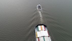 Aerial Footage of Tugboat Pulling Barge on Delaware River. Philadelphia PA stock video