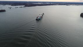 Aerial Footage of Tugboat Pulling Barge on Delaware River. Philadelphia PA stock video footage