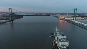 Aerial Footage of Tugboat`s Guiding a Reefer into Port. Philadelphia PA stock video footage
