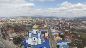 Aerial footage of Uzhgorod city center - top view of church in summer. Day time. Beautiful cloudy sky stock video footage