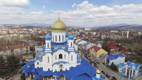 Aerial footage of Uzhgorod city center - top view of church in summer. Day time. Beautiful cloudy sky. 4K video stock video