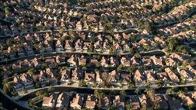 Aerial footage of Weeds Houses Homes Suburbs - Clip 1 stock footage