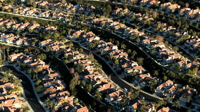 Aerial footage of Weeds Houses Homes Suburbs - Clip 2 stock footage
