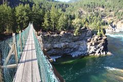 Aerial Footpath crossing the Wild Kootenai River in mountains of Northwestern Montana. This footpath crosses Part of the Kootenai Falls in Northwestern Montana stock image