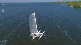 4K Aerial fotage. Trimaran near coast stock video