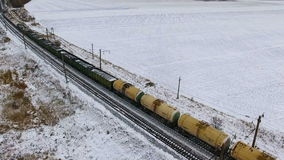 Aerial. Freight train with petroleum tanks passing by the railway. stock video