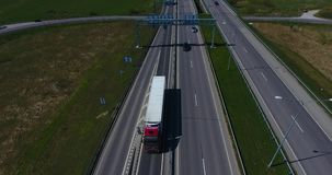 AERIAL: Freight truck transporting cargo container on a highway stock video