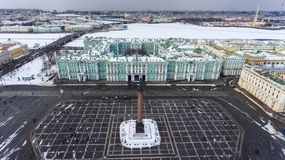 Aerial front view at the Winter Palace building, exterior with Palace Square and Aleksandr Column at winter season. Saint-Petersbu Royalty Free Stock Photography