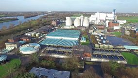 Aerial of the garbage incineration plant with it`s connected purification cleaning water and burning garbage stock video