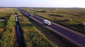 AERIAL: Gasoline tanker, Oil trailer, truck on highway. Very fast driving. AERIAL: Gasoline tanker, Oil trailer, truck on highway. Very fast driving stock video