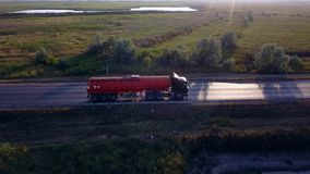 AERIAL: Gasoline tanker, Oil trailer, truck on highway. Very fast driving. AERIAL: Gasoline tanker, Oil trailer, truck on highway. Very fast driving stock video footage