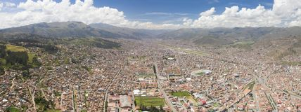 Aerial general view of Cusco city at daylight. Touristic destination in the Andes mountains of Peru. Panoramic angle depicting colonial city landscape and stock photo