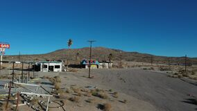 Aerial ghost town abandoned cafe Halloran Springs California pull 2 4K