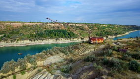 Aerial: giant mining excavator in a quarry stock video
