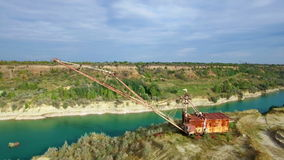Aerial: giant mining excavator in a quarry stock video footage