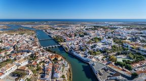 Aerial. The Gilao River and bridges in city of Tavira. Royalty Free Stock Photos
