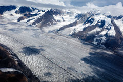 Aerial of glacier flow and crevasses that look like  smooth highways. Aerial of glacier flow and crevasses that look like a smooth highway Stock Photos