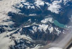 Aerial glacier view on the flight from Anchorage to Seattle Royalty Free Stock Images